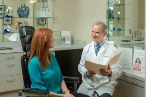 Dr. Stephen Lazarus discussing a plastic surgery procedure with a patient.
