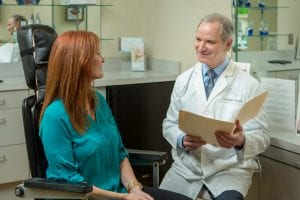 Dr. Stephen Lazarus discussion a medical procedure with a patient.